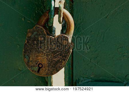Big old padlock on the iron door