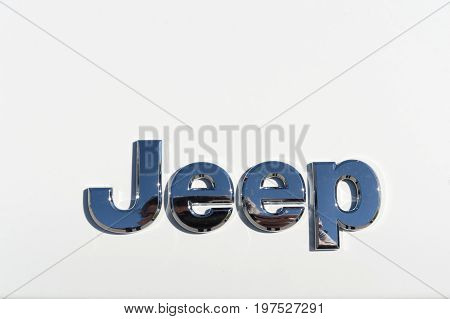 TURIN, ITALY - OCTOBER 5, 2016: Jeep logo on the front of a white Cherokee model