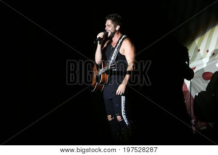 TWIN LAKES, WI-JUL 22: Thomas Rhett performs at Country Thunder Music Festival on July 22, 2017 in Twin Lakes, Wisconsin.
