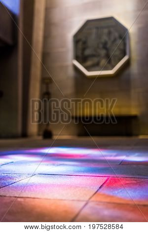 Montreal Canada - May 28 2017: Inside St Joseph's Oratory on Mont Royal with colorful reflections of stained glass murals in Quebec region city