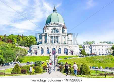 Montreal Canada - May 28 2017: St Joseph's Oratory on Mont Royal with people walking climbing steps in Quebec region city