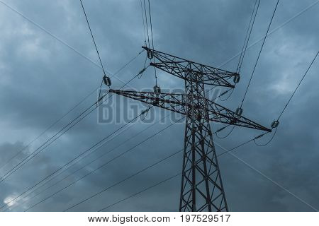 High Voltage Power Lines And Transmission Towers On A Cloudy Day. Poles And Overhead Lines Silhouett
