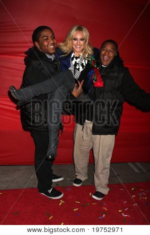 LOS ANGELES - NOV 28:  Chris Massey, Lacey Schwimmer, Kyle Massey arrive at the 2010 Hollywood Christmas Parade at Hollywood Boulevard on November 28, 2010 in Los Angeles, CA