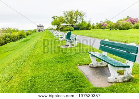 Quebec City Canada - May 30 2017: Martello tower watchtower in plaines d'Abraham with green grass field and many benches