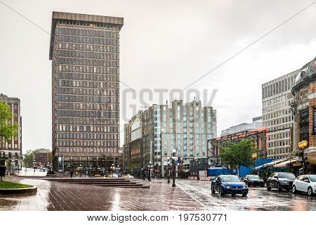 Quebec City Canada - May 31 2017: Place D'Youville during heavy rain in old town street with cars