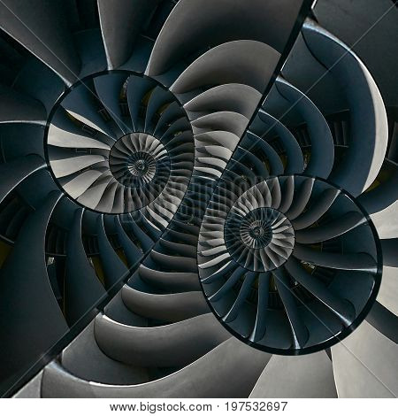 Turbine blades wings surreal spiral effect abstract fractal pattern background. Spiral industrial production metallic turbine background. Gray turbine blades technology abstract fractal pattern