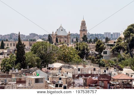 View of the Tower of David over the Tomb of King David in Dormition abbey and Jerusalem from the Corner tower of the Evangelical Lutheran Church of the Redeemer in the old city of Jerusalem Israel.