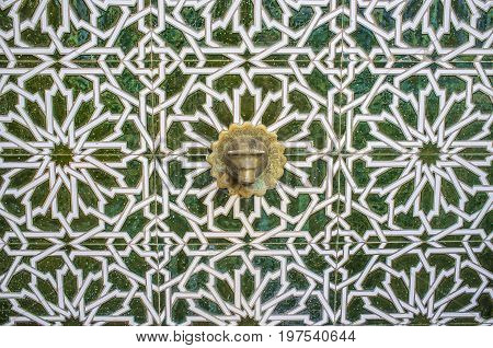 Tile arabic fountain at Old town street of Badajoz. Al-andalus decoration style Spain