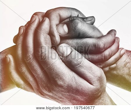 Men's hands hold the female palm on light toned background. That could mean help guardianship protection love care etc.