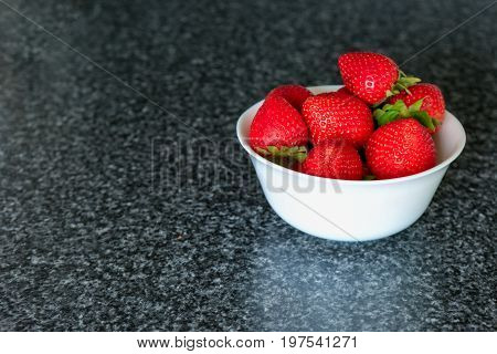 Small White Bowl Filled With Red Strawberries.