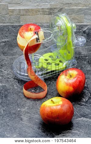 Apple and appel peeler close up photo