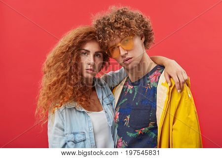 People, Style And Fashion. Studio Shot Of Attractive Freckled Ginger Girl With Long Curly Hair Embra
