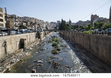 River with trash in the slums of the streets of Tripoli, Lebanon