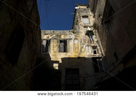 Detail of a sunlightened house with laundry in Tripoli, Lebanon
