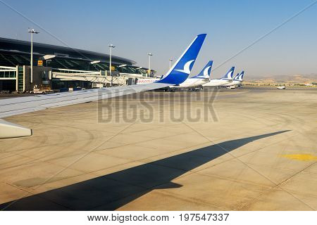 ANKARA, TURKEY - JULY 25, 2017: AnadoluJet airplanes parked at Esenboga International Airport. Anadolu Jet is a fully owned subsidiary of Turkish Airlines, It operates domestic flights within Turkey