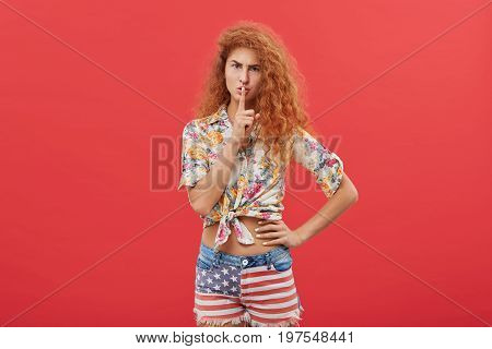Picture Of Beautiful Frowning Red-haired Woman With Long Curly Hairstyle Wearing Stylish Clothes Hol