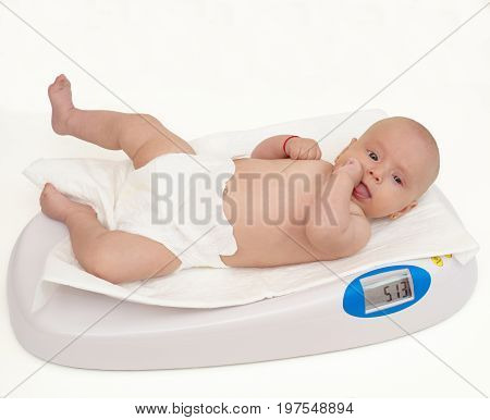 Baby on scale isolated on white background