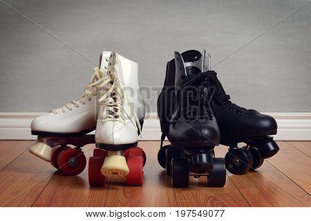 women and men quad roller skates on wood