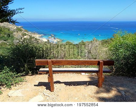 bench over sandy beach coast in the mediterranean sea landscape on Cyprus island