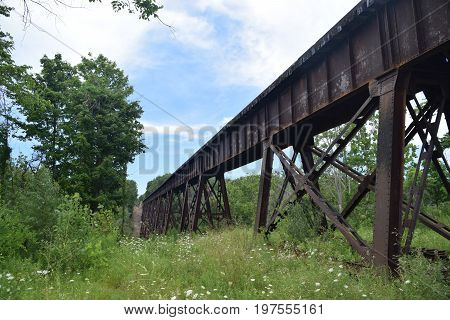 a long railroad trestle made out of steel and iron.