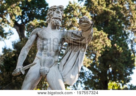 Florence ITALY - July 18 2017: The Greek Tyrantcidal statue is a copy of the statue of Aristogitone (447 b.C.) by Kritios and Nesiotes. It is located in the Boboli Garden along the main avenue. On white background.