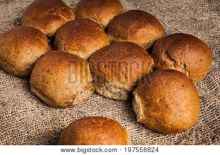 Freshly baked wheat-rye buns close-up. Delicious and healthy rustic bread