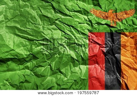 Zambia flag painted on crumpled paper background