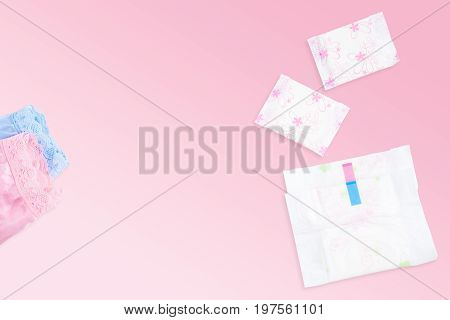 Sanitary napkins pads and lingeries in white blue and pink colour isolated on gradient light pink background with copy space for text insertion or decoration (clipping path included)