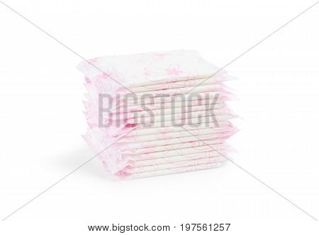 Sanitary napkin pads in stacks for female or woman use on menstrual period days in the month isolated on white background (clipping path included) women health and body care concept