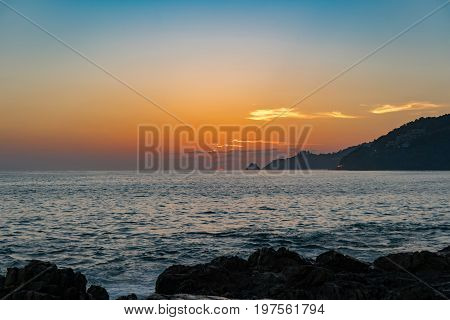 Beautiful colorful color and light sunset or sunrise over tropical andaman sea at phuket thailand