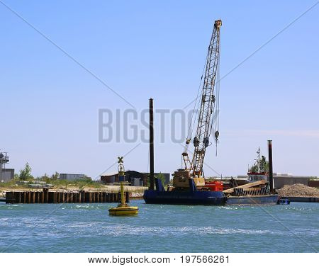 Cranes At A Shipyard For The Construction Of A Dam On The Sea