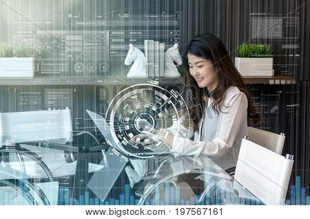 Portrait of smiling asian beautiful young businesswoman sitting at workplace with using the smart mobile phone with technology digital virtual screen Business lifestyle and technology concept