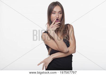Fashion beautiful woman with smeared lipstick. Glamour style. Sensual Posing