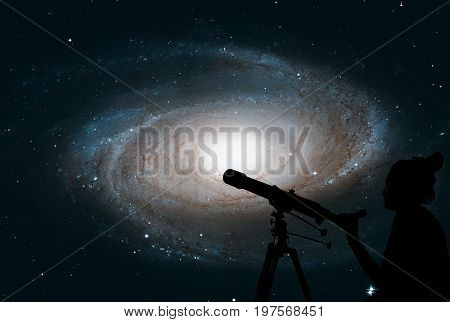 Girl Looking At The Stars With Telescope. Bode's Galaxy, M81, Sp