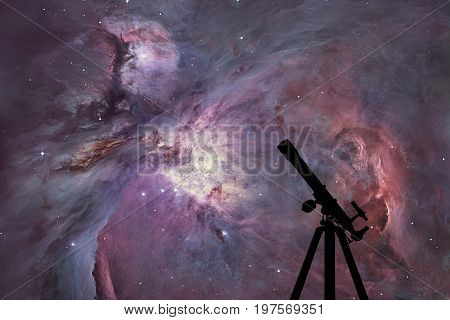 Space Background With Silhouette Of Telescope. The Orion Nebula Messier 42 Diffuse Nebula  In Conste