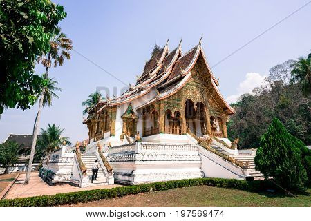 LUANG PRABANG LAOS - MARCH 11 2017: Beautiful architecture of Haw Pha Bang located on the grounds of the Royal Palace Museum in Luang Prabang Laos.