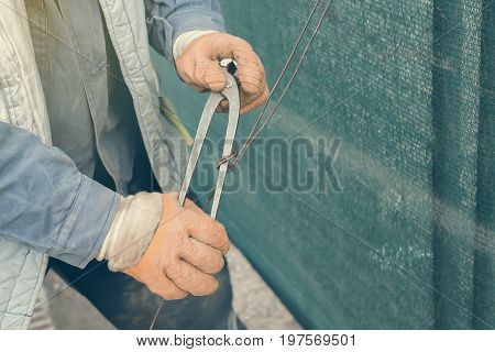 Tightening Wire Using A Pincers 3