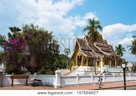 LUANG PRABANG LAOS - MARCH 11 2017: From outside the beautiful architecture of Haw Pha Bang located on the grounds of the Royal Palace Museum in Luang Prabang Laos.