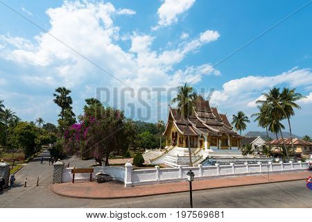 LUANG PRABANG LAOS - MARCH 11 2017: From outside wide angle picture of Haw Pha Bang located on the grounds of the Royal Palace Museum in Luang Prabang Laos.