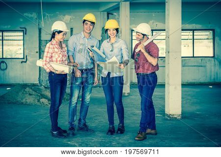 Multiethnic professional construction engineers working with Corporate Colleagues Teamwork and equipment blueprint at the building site place Industrial engineering Concept