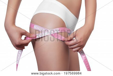 A Thin Woman Measuring Her Hips With A Yellow And Yellow Measuring Tape On A White Isolated Backgrou
