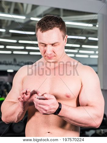 Man with smart device and use of mobile phone