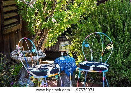 Two Ice Cream Chairs In Corner Of Quiet Garden