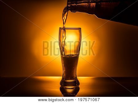 Dark Glass Beer Pouring On Light Background, Close Up