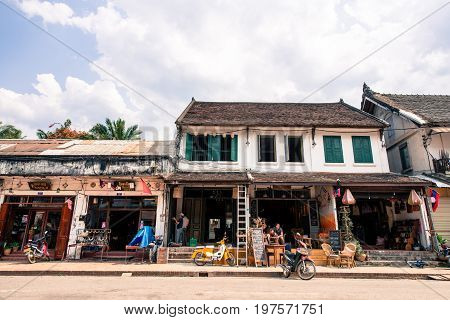 LUANG PRABANG LAOS - MARCH 11 2017: Horizonal picture of restaurants and stores at Sisavangvong Road located in the olf Quarter of Luang Prabang Laos.