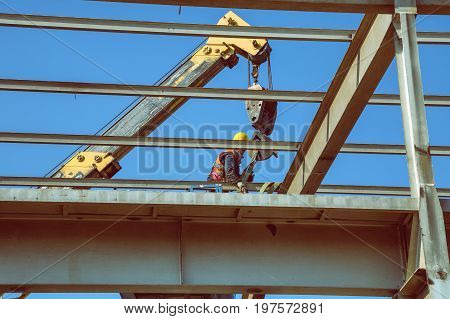 Worker High Above Dissembling Metal Structure 4