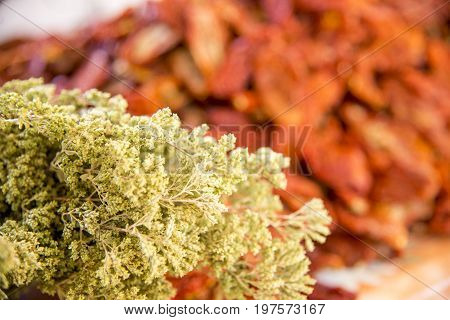 Dried tomatoes and herbs in the fresh food marketplace of Cefalu Italy