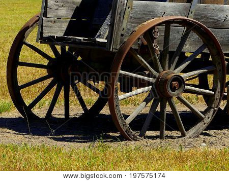 The rear cargo and wheel off of a Prairie Schooner.