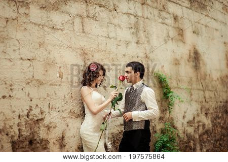 Bride Gives The Groom A Sniff Of A Red Rose