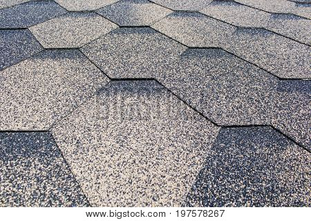 Asphalt Shingles Soft Focus Photo. Close up view on Asphalt Roofing Shingles Background. Roof Shingles - Roofing Construction, Roofing Repair.